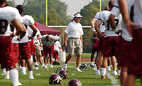 New head coach Steve Spurrier, center prowls the ranks of players during the team's first workout on the opening day of training camp Tuesday July 23, 2002 in Carlisle, Pa. (AP Photo/Brad C Bower)