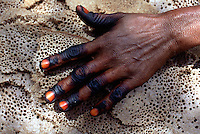 """Eritrea. Southern Debud Zone. Tseda. Small village in the country. A woman's hand with varnished nails and fingers painted in black on the local bread """"injera"""".  © 2002 Didier Ruef"""