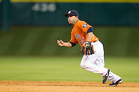Houston Astros second baseman Jose Altuve (27) on defense during the MLB baseball game against the Detroit Tigers on May 3, 2013 at Minute Maid Park in Houston, Texas. Detroit defeated Houston 4-3. (Andrew Woolley/Four Seam Images).