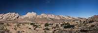 Panoramic view of the San Rafael Reef along Interstate 70 in Utah.  At the far right, a lone figure stands on a bluff to view the reef.