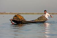 Myanmar, Burma.  Fisherman with his Nets, Inle Lake, Shan State.