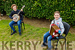 Mikey and Adam Fealy at home in Lixnaw playing music on Monday