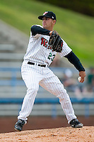 Relief pitcher Israel Chirino (23) of the Winston-Salem Warthogs in action versus the Frederick Keys at Ernie Shore Field in Winston-Salem, NC, Sunday, April 20, 2008.