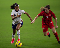 ORLANDO CITY, FL - FEBRUARY 18: Margaret Purce #20 runs at Allysha Chapman #2 with the ball during a game between Canada and USWNT at Exploria stadium on February 18, 2021 in Orlando City, Florida.