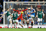 Wes Foderingham stands tall and denies Hibs