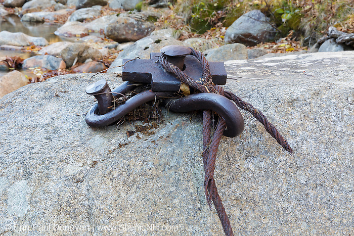Artifact (pins & cable), along the Sawyer River, in the abandoned village of Livermore in the New Hampshire White Mountains. This was a logging village in the late 19th and early 20th centuries along the Sawyer River Railroad.