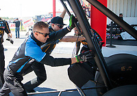 Apr 14, 2019; Baytown, TX, USA; NHRA top fuel driver Jordan Vandergriff works as a crew member for Austin Prock after losing a bet during their first career head to head matchup during the Springnationals at Houston Raceway Park. Mandatory Credit: Mark J. Rebilas-USA TODAY Sports