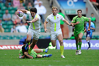 Mat Turner of England is tackled by Allan Fa'alava'au of Australia during the iRB Marriott London Sevens at Twickenham on Sunday 13th May 2012 (Photo by Rob Munro)