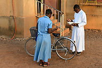 BURKINA FASO, Kaya, cathedrale, priest with comunity member in prayer