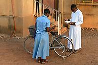 BURKINA FASO, Kaya, cathedrale, priest with comunity member in prayer