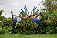 BNPS.co.uk (01202) 558833<br /> Pic: ZacharyCulpin/BNPS<br /> <br /> CAPTION UPDATE Life imitating art - Yoga teachers, Rachel Parker (right) and Lillie Hussain adopt similar poses to the sculptures near Dorchester before the start of the five-day festival, 'Wellbeing by the lakes'.<br /> <br /> The event aims to explore 'what it means to be mindful and live well in a fast-paced modern world' It is held is in the 26 acre Sculpture by the Lakes park in the heart of Dorset countryside.  <br /> <br /> There will be expert talks, guided meditations, yoga art and shopping, 'movement sessions', sound baths and healing therapies. It takes place from September 8 to September 12