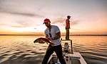 Michael Tolbert with a redfish on the flats at Shell Point with Justin Wallheiser.