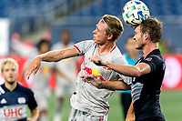 FOXBOROUGH, MA - AUGUST 29: Mathias Jorgensen #25 of New York Red Bulls and Henry Kessler #4 of New England Revolution battle for head ball during a game between New York Red Bulls and New England Revolution at Gillette Stadium on August 29, 2020 in Foxborough, Massachusetts.