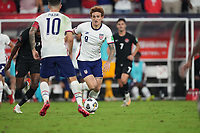 NASHVILLE, TN - SEPTEMBER 5: Josh Sargent #9 of the United States dribbles the ball towards team mate Christian Pulisic #10 during a game between Canada and USMNT at Nissan Stadium on September 5, 2021 in Nashville, Tennessee.