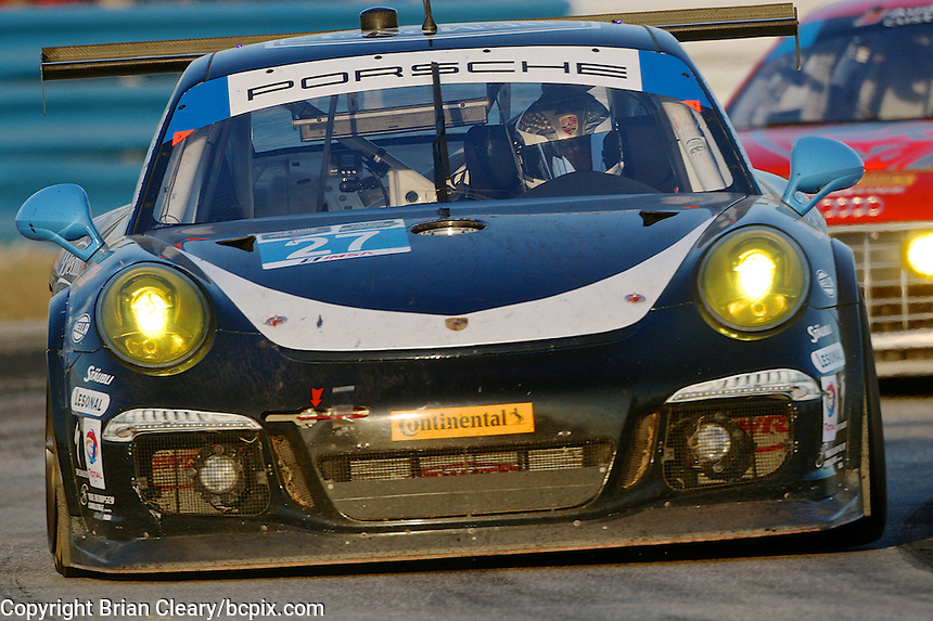 The #27 Porsche of Patrick Dempsey, Andrew Davis and Joe Foster races through a turn during the 12 Hours of Sebring, Sebring International Raceway, Sebring, FL, March 2014.  (Photo by Brian Cleary/www.bcpix.com)