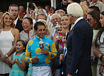 June 13, 2015 Jockey Victor Espinoza and trainer Bob Baffert accept their trophies for winning the 2015 Kentucky Derby with American Pharoah at Churchill Downs.  ©Mary M. Meek/ESW/CSM