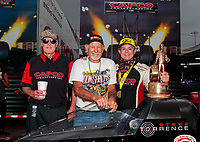 Sep 27, 2020; Gainesville, Florida, USA; NHRA top fuel driver Steve Torrence (right) celebrates with Don Garlits (center) and crew chief Richard Hogan after winning the Gatornationals at Gainesville Raceway. Mandatory Credit: Mark J. Rebilas-USA TODAY Sports