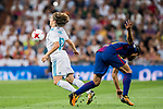 Luka Modric (l) of Real Madrid competes for the ball with Andre Filipe Tavares Gomes of FC Barcelona during their Supercopa de Espana Final 2nd Leg match between Real Madrid and FC Barcelona at the Estadio Santiago Bernabeu on 16 August 2017 in Madrid, Spain. Photo by Diego Gonzalez Souto / Power Sport Images