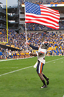 Virginia wide reciver Hasise Dubois waves the American Flag as he comes onto the field. The Virginia Cavaliers defeated the Pitt Panthers 30-14 in a football game at Heinz Field, Pittsburgh, Pennsylvania on August 31, 2019.