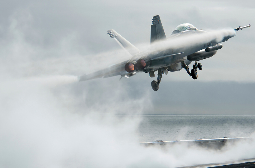 101217-N-7981E-171 PACIFIC OCEAN (Dec. 17, 2010)- An F/A-18F Super Hornet assigned to Strike Fighter Squadron 22 is enshrouded in vapor as it launches from the flight deck of USS Carl Vinson (CVN 70). Carl Vinson and Carrier Air Wing (CVW) 17 are currently on a three-week composite training unit exercise (COMPTUEX) followed by a western Pacific deployment. (U.S. Navy photo by Mass Communication Specialist 2nd Class James R. Evans / RELEASED)