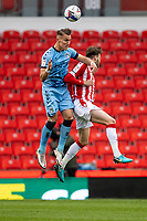 21st April 2021; Bet365 Stadium, Stoke, Staffordshire, England; English Football League Championship Football, Stoke City versus Coventry; Leo Ostigard of Coventry City climbs to head the ball