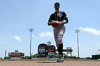 Omaha Storm Chasers outfielder Paulo Orlando (16) walks to the dugout in between innings during a game against the Nashville Sounds on May 20, 2014 at Herschel Greer Stadium in Nashville, Tennessee.  Omaha defeated Nashville 4-1.  (Mike Janes/Four Seam Images)