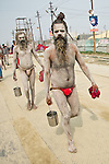 Naga Sadhus walking in a procession after taking holy bath in Ganges River in Allahabad for Kumbh Mela Festival.