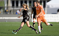 Leslie Osborne kicks the ball ahead of Yael Averbuch (right). FC Gold Pride defeated Sky Blue FC 1-0 at Buck Shaw Stadium in Santa Clara, California on May 3, 2009.