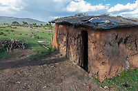 Tanzania.  Maasai House in Village of Ololosokwan, Northern Serengeti.