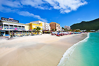 White sand beach turquoise water and waterfront diamond shop under a blue sky, in the beautiful Sint Maarten (Saint Martin), Caribbean Leeward Islands