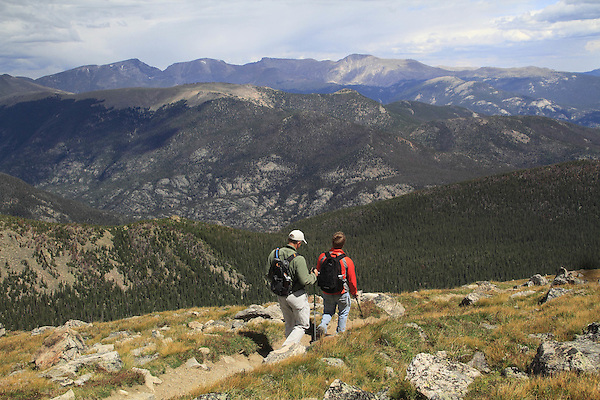 Caucasian father and son hiking the Flattop Mountain Trail in Rocky Mountain National Park, west of Estes Park, Colorado.