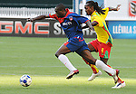 08 July 09: Haiti's Fabrice Noel (11) works past Grenada's Ricky Charles (9) during their match at the CONCACAF Gold Cup at RFK Stadium in Washington, DC.