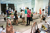 Shoppers browse through a shoe & bags store at the Pavilion, a high end shopping mall in Kuala Lumpur, Malaysia.