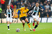 2nd October 2021;  Molineux Stadium, Wolverhampton,  West Midlands, England; EFL Cup football, Wolverhampton Wanderers versus Newcastle United; Jeff Hendrick of Newcastle United attempts to pull back Francisco Trincao of Wolverhampton Wanderers