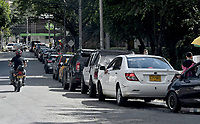 CALI - COLOMBIA, 09-05-2021: Largas filas para abastecerse de combustible en el sector de La Portada en Cali Colombia hoy, 09 mayo de 2021, durante el doceavo día de protestas del Paro Nacional convocado por la reforma tributaria y de la salud que adelanta el gobierno de Ivan Duque además de la precaria situación social y económica que vive Colombia. Durante el día se presentaron bloqueos intermitentes y además recibieron el apoyo de la Minga Indígena. El paro fue convocado por sindicatos, organizaciones sociales, estudiantes y la oposición y sumando el día del trabajo lleva 11 días de marchas y protestas. / Drivers and motorcyclists wait their turn to fill up at a gas station at La Portada sector in Cali Colombia today, May 08, 2021, during the twelfth day of protests of the National Strike called for the tax and health reform carried out by the government of Ivan Duque in addition to the precarious situation social and economic life in Colombia. During the day there were intermittent blockades and they also received the support of the Indigenous Minga. The strike was called by unions, social organizations, students and the opposition and adding up to Labor Day it has been 11 days of marches and protests . Photos: VizzorImage / Gabriel Aponte / Staff