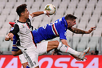 Cristiano Ronaldo of Juventus and Julian Chabot of UC Sampdoria compete for the ball during the Serie A football match between Juventus FC and UC Sampdoria at Juventus stadium in Turin (Italy), July 26th, 2020. Play resumes behind closed doors following the outbreak of the coronavirus disease. <br /> Photo Federico Tardito / Insidefoto