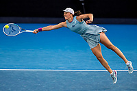 14th February 2021, Melbourne, Victoria, Australia; Iga Swiatek of Poland returns the ball during round 4 of the 2021 Australian Open on February 14 2020, at Melbourne Park in Melbourne, Australia.