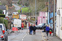 Pictured: Fire service personnel in New Road.<br /> Re: Cleanup after storm Dennis in Crickhowell, Wales, UK.