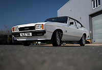 BNPS.co.uk (01202) 558833. <br /> Pic: MattRichardson/Classic Ford/BNPS<br /> <br /> Pictured: The restored car. <br /> <br /> The legendary Ford Capri that starred in '80s TV show Minder has been restored to its former glory after a devastating fire wrecked the car.<br /> <br /> The 1977 white motor which appeared on the opening titles of the comedy-drama caught ablaze while it was returning from an MoT test last year.<br /> <br /> It is thought an electrical fault in the engine bay caused the fire. <br /> <br /> Now a mechanic who specialises in classic car restorations has unveiled the famous Ford after fixing it up over the past six months.