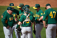 Siena Saints head coach Tony Rossi (40) talks with starting pitcher Chris Amorosi (24) as Jordan Folgers (12), Phil Madonna (3), Tyler Martis (hidden), Jordan Bishop (4), and Joe Drpich (47) listen in during a game against the UCF Knights on February 21, 2016 at Jay Bergman Field in Orlando, Florida.  UCF defeated Siena 11-2.  (Mike Janes/Four Seam Images)