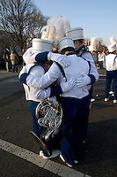 The band from Punahou School in Hawaii stay warm as they wait to march in the parade after the inauguration of Barack Obama as the 44th President of the United States. Obama attended the school as a child.