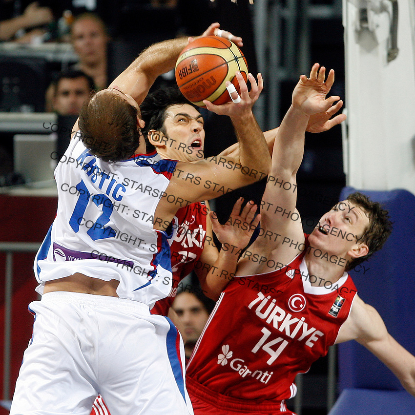 Kerem GONLUM (Turkey) and Omer ASIK (Turkey) blocks Nenad KRSTIC (Serbia)  during the semi-final World championship basketball match against Serbia in Istanbul, Serbia-Turkey, Turkey on Saturday, Sep. 11, 2010. (Novak Djurovic/Starsportphoto.com) .
