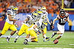 Michigan defeats Virginia Tech, 23-20, in the Allstate Sugar Bowl played at the Mercedes-Benz Superdome in New Orleans.<br /> <br /> All images in this gallery appear solely as a representation of my photography and are not available for purchase or further distribution.