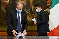 The Italian Minister of Economy Roberto Gualtieri and the Italian premier Giuseppe Conte and wearing face masks during the press conference about the economic maneuver.<br /> Rome (Italy), October 19th 2020<br /> Photo Pool Stefano Carofei Insidefoto