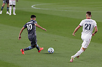 ST PAUL, MN - SEPTEMBER 06: Emanuel Reynoso #10 of Minnesota United FC passes the ball past Tate Schmitt #21 of Real Salt Lake during a game between Real Salt Lake and Minnesota United FC at Allianz Field on September 06, 2020 in St Paul, Minnesota.