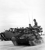 Ontos on Chu Lai beach search for a defensive position shortly after descending from the landing crafts aboard the USS Thomaston. June 1965. Navy. (USIA)<br /> EXACT DATE SHOT UNKNOWN<br /> NARA FILE #:  306-MVP-16-8<br /> WAR & CONFLICT BOOK #:  399