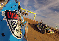 Dec. 11, 2011; Chandler, AZ, USA; Onboard view from the truck of LOORRS pro two unlimited driver Robby Woods as Kyle LeDuc attempts to pass on the inside during the Lucas Oil Challenge Cup at Firebird International Raceway. Mandatory Credit: Mark J. Rebilas-