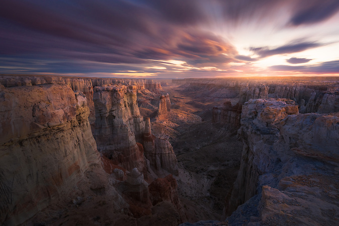 Cloud streaks rendered by a long exposure as the pre-dawn light filters through the canyon walls in Arizona.