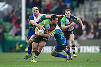 Maurie Fa'asavalu of Harlequins offloads as he is tackled by David McSharry (right) and Mick Kearney of Connacht Rugby during the Heineken Cup match between Harlequins and Connacht Rugby at The Twickenham Stoop on Saturday 12th January 2013 (Photo by Rob Munro).