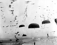 Parachutes open overhead as waves of paratroops land in Holland during operations by the 1st Allied Airborne Army. September 1944. (Army)<br /> Exact Date Shot Unknown<br /> NARA FILE #:  111-SC-354702<br /> WAR & CONFLICT BOOK #:  1066